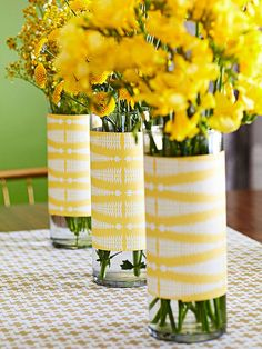 Wrapping patterned paper around simple glass vases created a beautiful centerpiece for not a lot of cash. Plus, it's easy to change the look by just switching out the paper.
