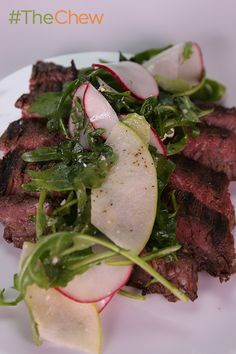 Don't settle for plain steak, adds tons of flavor by marinating it first to make a delicious Marinated Skirt Steak with Arugula Radish Salad by Michael Symon! #TheChew