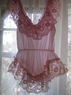 (via Damaged Dolly's vintage   Vintage Pink Lace Teddy Lingerie szM   Online Store Powered by Storenvy)  Added some new items to my store!