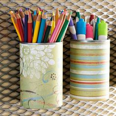 Recycled soup cans make great holders for writing utensils. Install pan-head screws through the backs of the cans to mount them to the wall