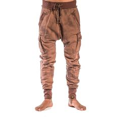 Men's slightly drop crotch sweatpants in a Smoke Dye wash. Details include raw finishes, draw-string tie, brass grommets, 2 cargo pockets and a stash pocket. Matching hoodie available.