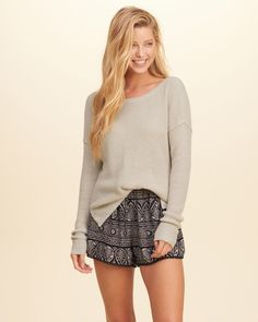 A basic crewneck sweater with an Easy Fit in mid-length, featuring allover…