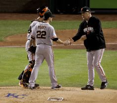San Francisco Giants manager Bruce Bochy, right, takes starting pitcher Jake Peavy out of the game during the second inning of Game 6 of baseball's World Series against the Kansas City Royals Tuesday, Oct. 28, 2014, in Kansas City, Mo. (AP Photo/Charlie Riedel)