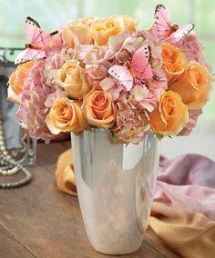 Peach Pink Arrangement in beautiful silver vase with butterflies.JPG