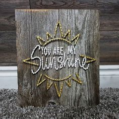 You are my sunshine ☀  #newlove #dreamcatchersbykelsie #sunflower #tractor #spring #stringart #crafts #summer #barnboard #handmade #homedecor #country #rustic #custom #hockey #mapleleafs #concessionstreetfest #pineapple #youaremysunshine #crystals