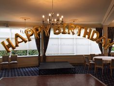 Happy Birthday Balloon Arch created with super shape gold letter balloons.