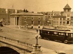 A trolley car moves across the Virginia Street Bridge