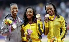 United States' Carmelita Jeter, silver, Jamaica's Shelly-Ann Fraser-Pryce, gold, and Jamaica's Veronica Campbell-Brown, W100m medalists.