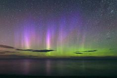 A view displaying the Northern Lights affected by the solar tsunami over Lake Superior on Aug. 4, 2010 in Marquette, Michigan, captured by photographer Shawn Malone, 46, just before midnight. Malone spent just over an hour and half each night observing the enhanced natural phenomenon and used exposures lasting 20 minutes. Photo by Shawn Malone / lakesuperiorphoto.com / Barcroft USA / Getty Images.