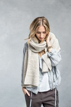 play with textures and add a chunky knit oversize scarf to soft t-shirt layers