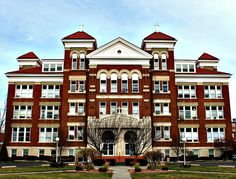 Siena Heights University - Adrian, Michigan - Siena Heights University is rumored to have a haunted room in one of its dorms. At least, Room 211 is said to have been haunted in the 1970s. A witness reported that doors opened and closed, and glowing eyes came out of nowhere in the middle of a wall. A chair rocked by itself and smashed a mirror.