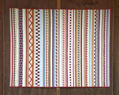 Maryandpatch, Neuchatel Patchwork, Seminole Quilt. Each row is made from tiny pieced blocks. Made by a Swiss quilt guild (Neuchatel Patchwork).