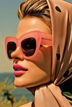 i want big sunglasses. and a scarf. and this girls face. that's all.
