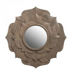 Lotus Mirror by designer Ashley Childers for Emporium Home is beautifully hand carved from solid wood. The delicate and layered petal like design will adorn any wall with grace and beauty.