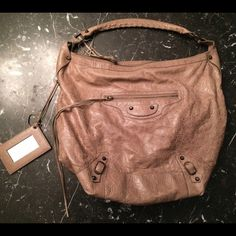 Balenciaga Classic Day Bag % Authentic Retails for $1365.00 Great condition!! Little signs of wear on back  Taupe Balenciaga Classic Day hobo with zip pocket on front, brass-tone stud detail, interior side zip pocket and compartments, top zip closure.  No trades. Will provide additional pictures if needed to! Balenciaga Bags Shoulder Bags
