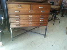 """Beautifully restored vintage flat file drawers on custom steel stand.  Great for storage in the bedroom, office, or kitchen.   41""""w x 28""""d x 42""""h"""