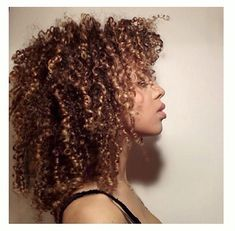 unrulycurls festival hair for the summer season from london salon and hair studio - those curls though! Mine aren't quite this tight (or plentiful), but I can dream, right? Also, this girl looks like my main character in the CAP trilogy...