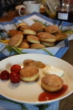 Biscuits, strawberries, jam and sour cream