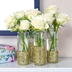 Get Your Glitter on With This Shot-Glass DIY: If you're looking for a fun DIY that makes your space instantly sparkle, these shot-glass vases are a real stunner.