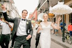 Newlyweds Lead Second Line in New Orleans    Photography: Arte de Vie   Read More:  http://www.insideweddings.com/weddings/modern-wedding-with-southern-traditions-in-new-orleans-louisiana/712/