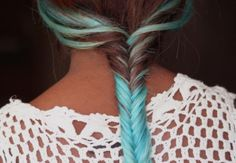 Brunette fishtail braid with baby blue highlights/tips.