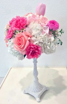 I love this little elevated, candlestick base. Hydrangea, carnations, roses, and tulips. Adorna Design at TerrAdorna.