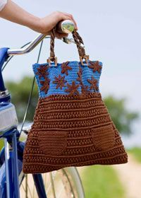 Dressy Crochet shopping bag ~ free pattern on Coats and Clark! Such a cute shape and adorable pockets!!!.