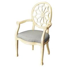 """Hand-carved wood arm chair with an openwork back and striped upholstery.   Product: ChairConstruction Material: Wood and polyesterColor: Blue and creamFeatures:   Hand-carvedOpenwork backDimensions: 41.5"""" H x 26.5"""" W x 23.5"""" D"""