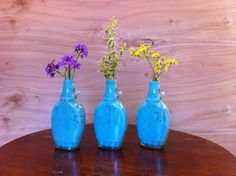 Love the antique color. Reused maple syrup bottles painted inside.