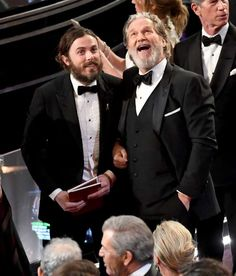 Actors Casey Affleck ﴾L﴿ and Jeff Bridges enjoy a joke together.