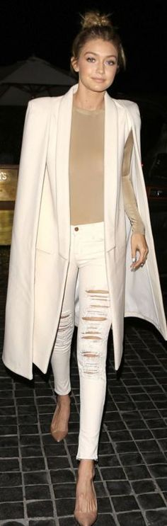 Gigi Hadid: Jeans – J Brand  Jewelry – Monica Rose x Sarah Chloe Jewelry  Cape – Olcay Gulsen