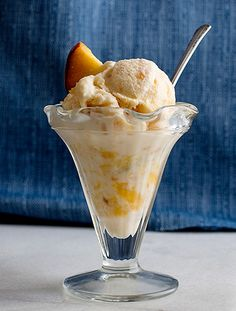 Swan House Peach Ice Cream recipe, with only four ingredients. The recipe was first published in 1928 by the Atlanta Journal's home economics page editor, Mrs. S.R. Dull. Ingredients: 1 quart peaches, peeled and mashed in a bowl, 3 cups sugar, divided, 4 cups whipping cream, and 1 tbsp. vanilla extract. | Garden & Gun