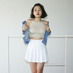 """Meg is springing forward in the White Tennis Skirt, Denim Jacket and Sleeveless Crop top. #aamodels #americanapparel #aaoutfit"""