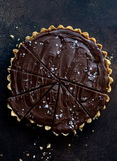 This snickers almond tart is made with an almond crust, homemade almond butter caramel and a chocolate ganache. Its to die for!