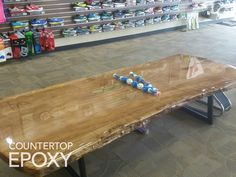 Clear epoxy over wood bench. DIY thick, epoxy coating.
