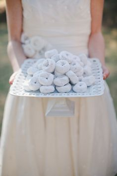 """I often tell brides, """"Go simple to save"""" and this is a great example.  Powdered donuts on a nice white plate fits right in with a White Wedding theme and into a tight budget.  And your guests are bound to gobble them up, too."""
