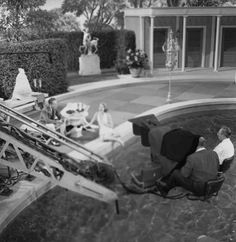 High-angle shot of Bing Crosby and Grace Kelly filming High Society