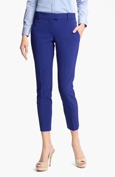 This cropped style would look good on you, especially because the vertical crease in the pant legs lengthen and elongate. This is a tailored cut, so it will be fitted without being overly tight. The inseam on you would probably hit right at your ankle, which is great!