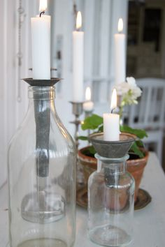 Great idea! Old  metal funnel placed in bottle for a candle holder