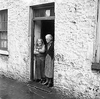Bridget O'Riordan and Mrs. Mary Kelly standing at the door of their rooms at the Corporation Widows Alms House, Limerick. Images Of Ireland, County Cork, Photo Archive, Mary, Rooms, House, Bedrooms, Home, Homes