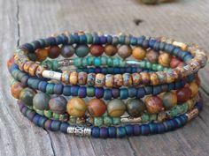 This memory wire bracelet will go with everything you wear. The seed bead and beads are in tones of blue, turquoise,silver and earth tones. Casual