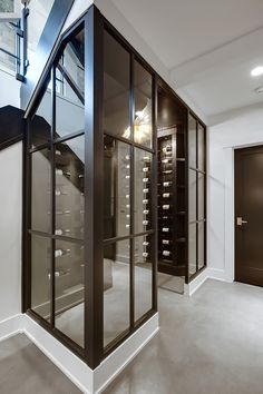 Wine Enclosure Wood and glass walls with glass door leads to the wine room Glass Wine Cellar, Home Wine Cellars, Wine Cellar Design, Wine Cellar Basement, Glass Partition Wall, Wine Display, Glass Door, Glass Walls, Glass House
