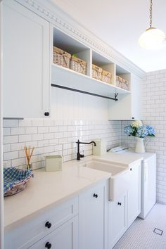 Love the cornicing detail, butler sink and hanging rack