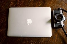 Closed macbook and a vintage camera   Free Non-Stock Photo
