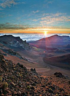 Watch the sunrise from the top of a mountain.     Haleakala Sunrise  By: Steven Snyder