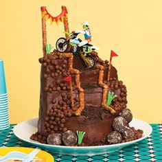 #Motocross Mountain Climb #Cake  Covered with cereal gravel and strewn with doughnut-hole boulders, this multitiered mountain is sure to win fans at a party with a dirt bike, X Games, or #Motocross motif.