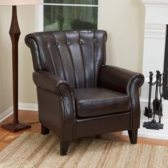 This tufted leather chair adds a sleek and sophisticated accent to any room. The sturdy wood construction features espresso-stained legs and bonded leather upholstery with channel tufting. Padded arms, back and seat add inviting comfort.