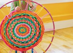 2. Are you into weaving? Want to get into weaving? You can make this Hula Hoop rug out of old T-shirts. Great use for a hula hoop too – you ...