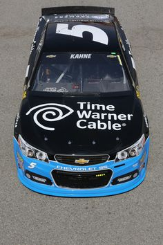 Kasey Kahne drives the #5 Time Warner Cable Chevrolet through the garage area during practice for the NASCAR Sprint Cup Series Auto Club 400 at Auto Club Speedway on March 21, 2014 in Fontana, California.   #NASCAR2014