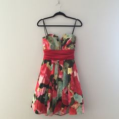Strapless, empire waist floral dress. Red, green, and yellow floral pattern with very flattering empire waist and unique neckline. Worn once to graduation and again to a summer wedding. B. Darlin Dresses Strapless